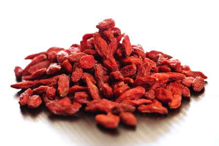 goji: Loose pile of red dried goji berries