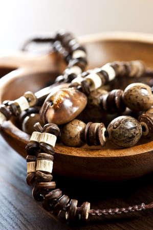 Hand made wood shell and bone jewelry photo