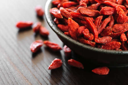 Full bowl of red dried goji berries Stock Photo - 5368175