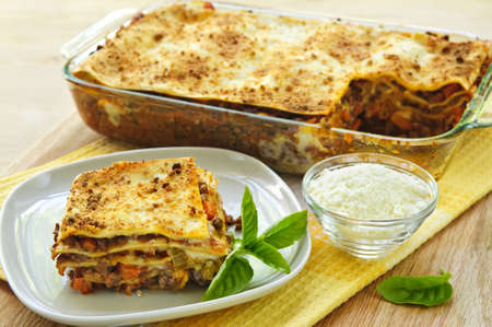 Fresh baked lasagna casserole with a serving cut photo