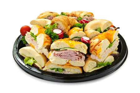 party tray: Isolated assorted platter of sandwiches with meat and vegetables