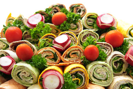 cater: Closeup on platter of assorted meat tortilla wraps Stock Photo
