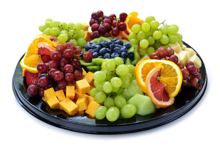 Isolated platter of assorted fruit and cheese photo