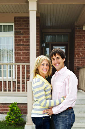 Young happy couple in love at home Stock Photo - 5395616