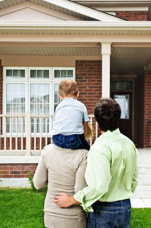 real estate: Young happy family shopping for new home Stock Photo