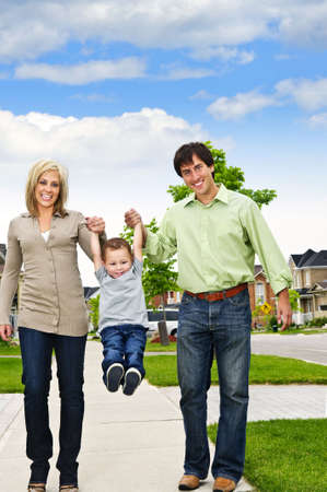 Young happy family playing with son on sidewalk Stock Photo - 5395617