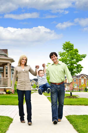 Young happy family playing with son on sidewalk Stock Photo - 5395627