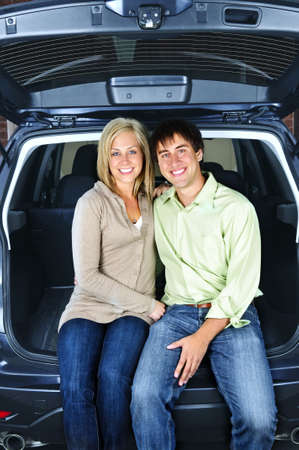 Happy young couple sitting at back of car Stock Photo - 5395774