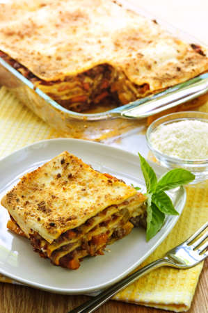 Fresh baked lasagna casserole with a serving cut Stock Photo - 5395807