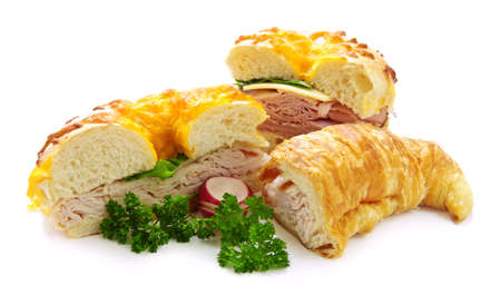 Assorted bagel and croissant sandwiches with meat and vegetables photo
