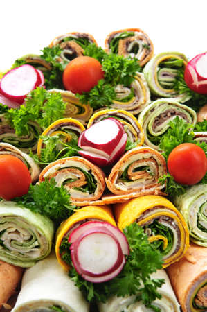 vegetable tray: Closeup on platter of assorted meat tortilla wraps Stock Photo