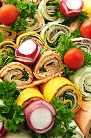 Closeup on platter of assorted meat tortilla wraps photo
