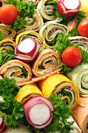 tortilla: Closeup on platter of assorted meat tortilla wraps Stock Photo