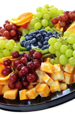 Platter of assorted fresh fruit and cheese Imagens