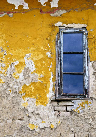 Old weathered painted wall and window for grunge background Stock Photo - 5436445