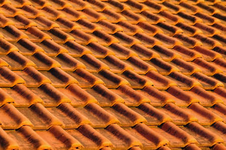 interlocking: Closeup of red clay interlocking roofing tiles background