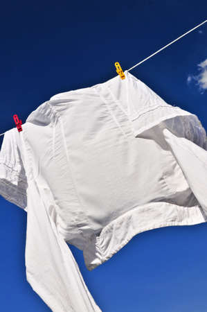 White shirt hanging to dry on clothes line photo