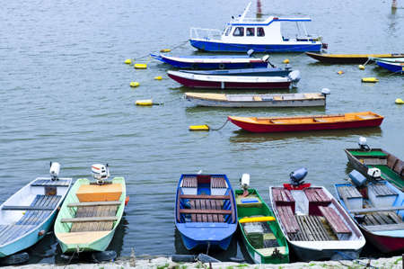 dinghies: Many small fishing boats anchored on Danube river in Belgrade