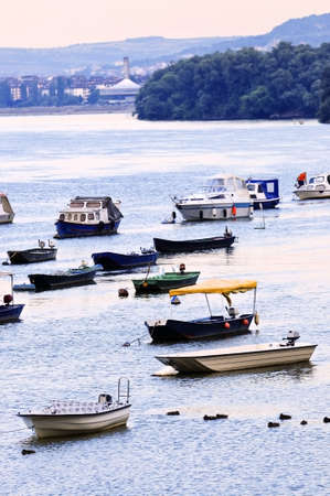 Many small fishing boats anchored on Danube river. View from Zemun part of Belgrade. photo