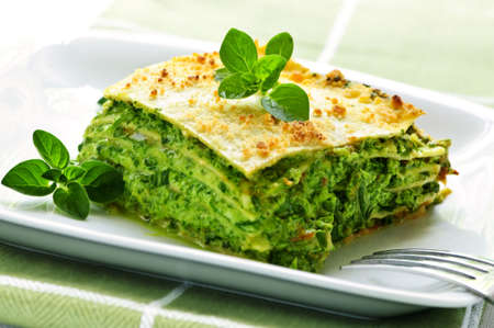 lasagna: Serving of fresh baked vegeterian spinach lasagna on a plate