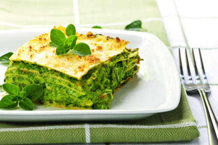 vegeterian: Serving of fresh baked vegeterian spinach lasagna on a plate