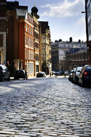 gravel roads: Cobblestone paved street in London on sunny day