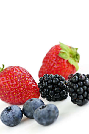 Closeup of assorted fresh berries isolated on white background Stock Photo - 5553916