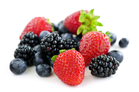 Closeup of assorted fresh berries isolated on white background Foto de archivo
