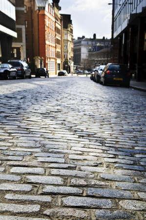 brick: Cobblestone paved street in London on sunny day