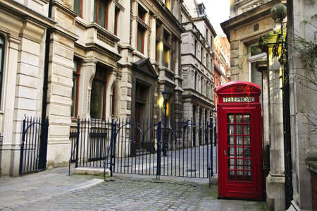 europeans: Red telephone box near old buildings in London