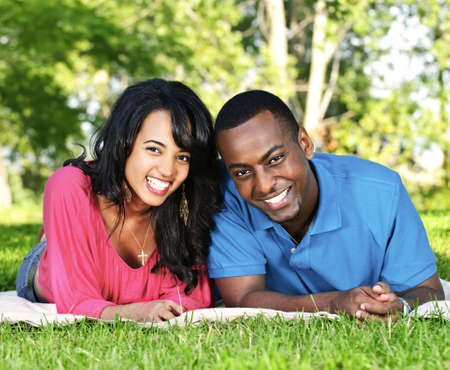 Young romantic couple enjoying summer day in park Stock Photo - 5560244