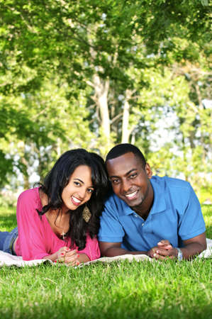 minority couple: Young romantic couple enjoying summer day in park