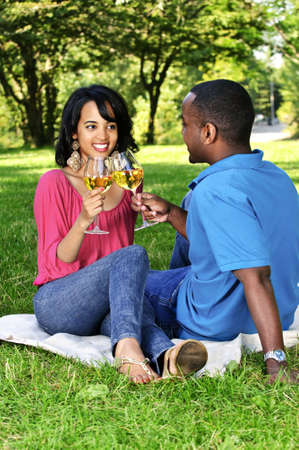 Young romantic couple celebrating with wine in summer park Stock Photo - 5560334