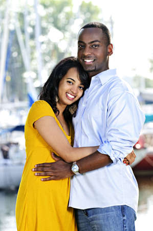 Young romantic couple hugging and standing at harbor Stock Photo - 5560324