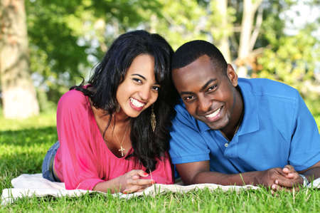 Young romantic couple enjoying summer day in park photo