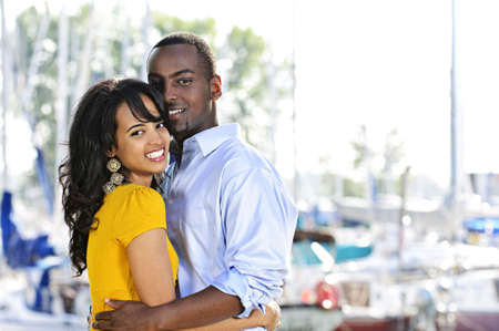 Young romantic couple hugging and standing at harbor Stock Photo - 5594246