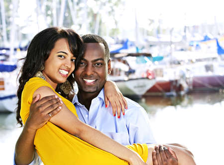 Portrait of man carrying his girlfriend standing at harbor Stock Photo - 5594255