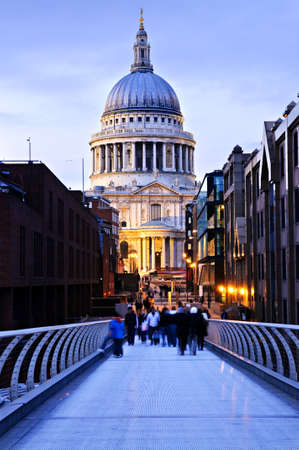st pauls: View of St. Pauls Cathedral in London from Millennium Bridge at dusk