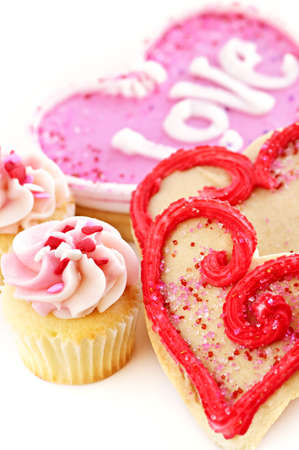 Homemade baked shortbread Valentine cookies and cupcakes with icing on white background Stock Photo - 5618903