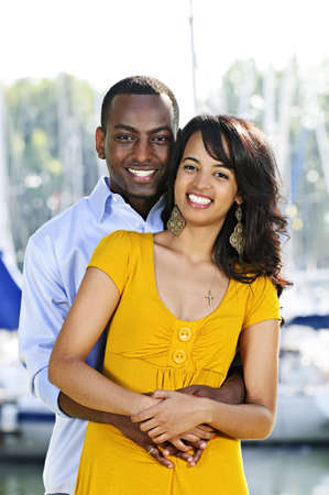 Young romantic couple hugging and standing at harbor Stock Photo - 5618958