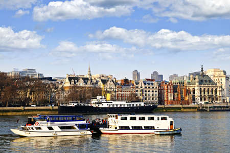 britannia: London skyline view from Thames river against blue sky Stock Photo