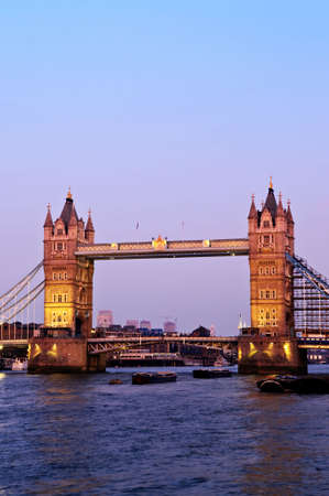 Tower bridge in London England at sunset over Thames river photo