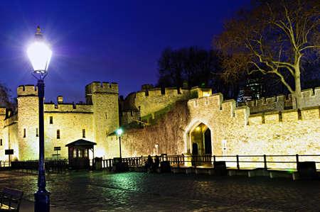 britannia: Illuminated Tower of London walls at night