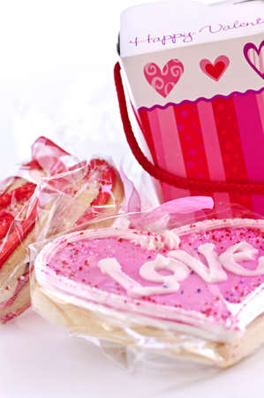 Homemade baked shortbread Valentine cookies with icing and gift boxes photo