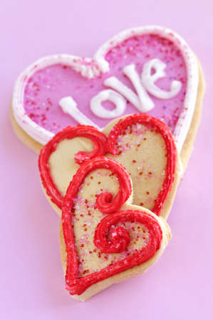 shortbread: Homemade baked shortbread Valentine cookies with icing on pink background