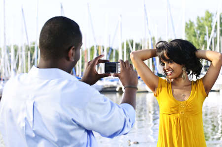 Beautiful woman posing for vacation picture at harbor photo