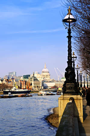 View of St. Pauls Cathedral from South Bank of Thames river in London photo