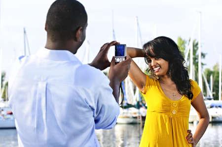Beautiful woman posing for vacation photo at harbor photo