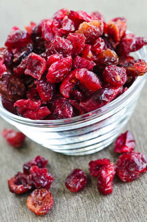dried fruit: Dried cranberries spilling out of glass bowl