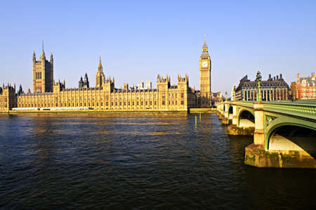 Houses of Parliament with Big Ben and Westminster Bridge in London photo